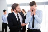 Businessman consoling his depressed colleague — Stock Photo