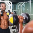 African man training with dumbbells — Stock Photo #60278431