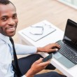 African man in formalwear working on laptop — Stock Photo #60278785