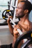 African man working out on bench press — Stock Photo