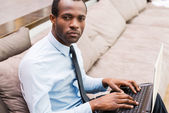 African man in formalwear working on laptop — Stock Photo
