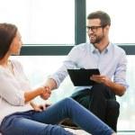 Male psychiatrist shaking hand to woman — Stock Photo #60280275