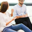Worried woman sitting and male psychiatrist — Stock Photo #60280283