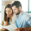Man and woman looking at documents — Stock Photo #60280425