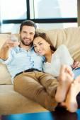 Loving couple  watching TV — Stock Photo