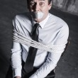Businessman with adhesive tape on his mouth — Stock Photo #60758791