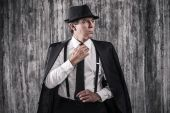 Bossy senior man in gangster clothing — Stock Photo