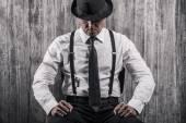 Bossy senior man in gangster clothing — Stock Photo