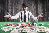 Man in shirt and suspenders sitting at the poker table — Stock Photo