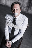 Businessman with adhesive tape on his mouth — Stock Photo
