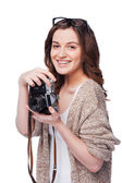 Smiling woman holding camera — Stock Photo