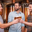 Young men in casual wear toasting with beer — Stock Photo #61925343