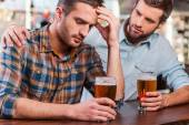Depressed man sitting at the bar counter — Stock Photo