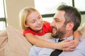 Little girl embracing her cheerful father — Stock Photo