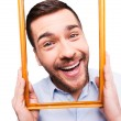 Handsome man holding picture frame — Stock Photo #62630133