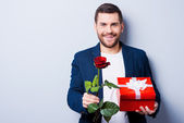Man giving  gift and flower to you — Stock Photo