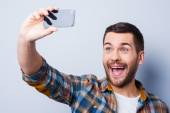 Man in shirt holding mobile phone — Stock Photo