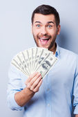 Man holding paper currency — Stock Photo