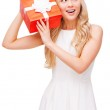 Woman holding gift box — Stock Photo #62790541