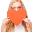 Woman holding heart Valentine card — Stock Photo #62790567