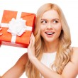 Woman holding gift box — Stock Photo #62790571