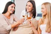 Women toasting with wine — Stock Photo