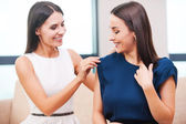 Woman helping friend with dressing — Stock Photo