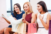 Women looking at bought clothes — Stock Photo
