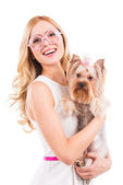 Blond woman carrying Yorkshire terrier — Stock Photo