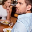 Frustrated young man in restaurant — Stock Photo #63946321