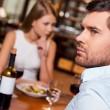 Frustrated young man in restaurant — Stock Photo #63946329