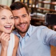Couple making selfie in restaurant — Stock Photo #63946347