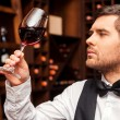 Sommelier examining glass with wine — Stockfoto #63946413