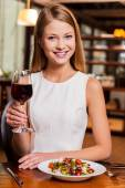 Woman toasting with wine — Stock Photo