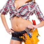 Woman wearing  tool belt — Stock Photo #64524495