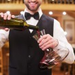 Man pouring red wine — Stock Photo #64998185