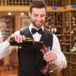 Man pouring red wine — Stock Photo #64998191