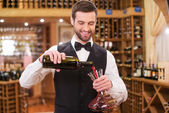Man pouring red wine — Stock Photo