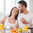 Young couple smiling in kitchen — Stock Photo #65728553