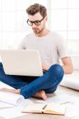 Thoughtful young man working on laptop — Foto Stock