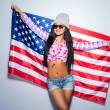 Young woman carrying American flag — Stock Photo #66507955