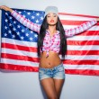 Young woman carrying American flag — Stock Photo #66507833