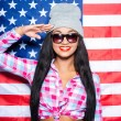 Young woman against American flag — Stock Photo #66508019