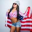 Young woman covered with American flag — Stock Photo #66508069