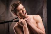 Young man choking by necktie — Stock Photo