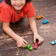 Little boy playing with toy cars — Stock Photo #67522269