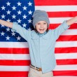 Little boy keeping arms raised — Stock Photo #67522483