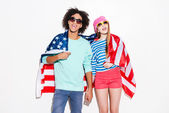 Сouple covering with American flag — Stok fotoğraf