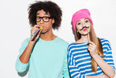 Funky young couple making faces — Stock Photo