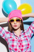 Young woman in headwear and glasses — Stock Photo